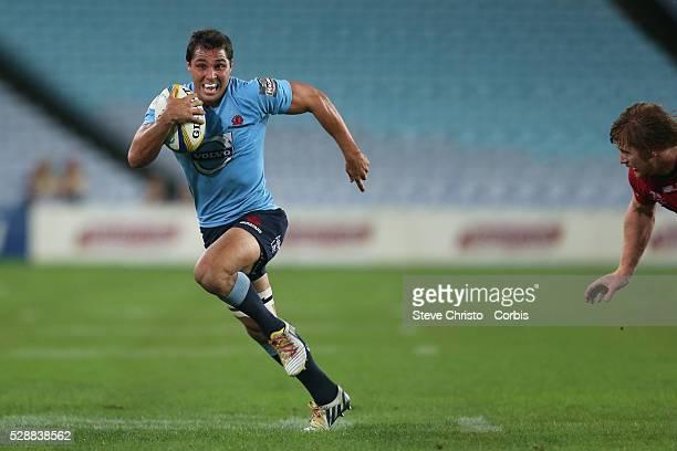 Waratahs Nick Phipps runs the ball up during the match against the Warartahs at ANZ Stadium Sydney Australia Saturday 1st March 2014