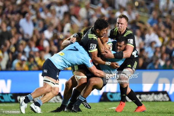 Waratahs player Karmichael Hunt hit in a tackle from Hurricanes player Ardie Savea at The Super Rugby game between NSW Waratahs and Hurricanes on...