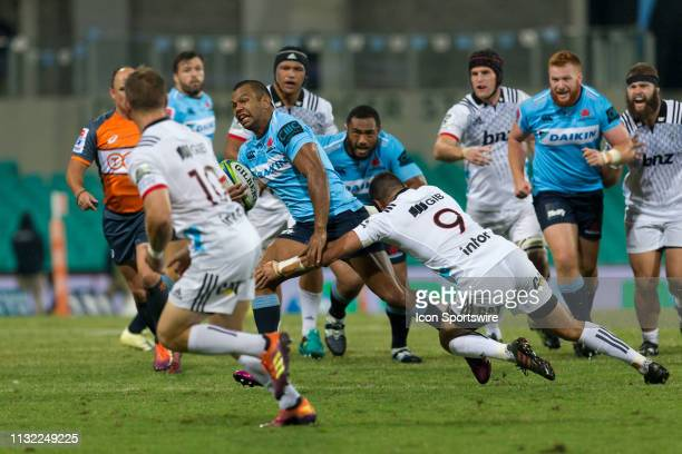 Waratahs player Kurtley Beale is tackled by Hurricanes player TJ Perenara at round 6 of Super Rugby between NSW Waratahs and Crusaders on March 23,...