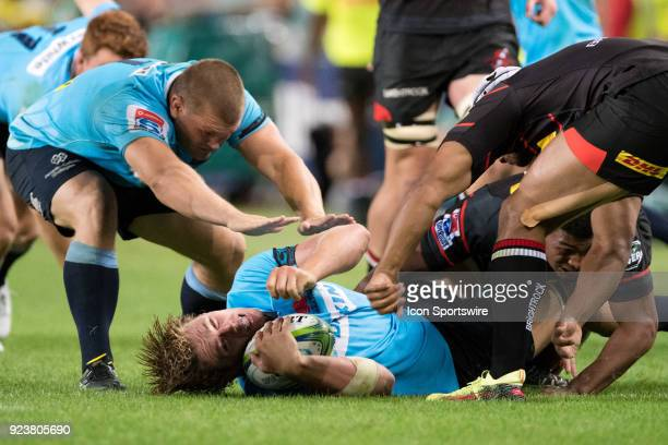 Waratahs player Ned Hanigan hit in a big tackle at round 2 of the Super Rugby between The Waratahs and Stormers at Allianz Stadium in Sydney on...