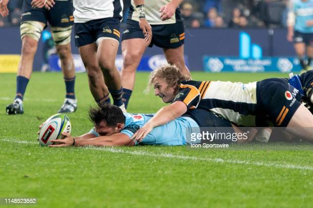 Waratahs player Nick Phipps breaks a tackle to score at week 17 of Super Rugby between NSW Waratahs and Brumbies on June 08 2019 at Western Sydney...