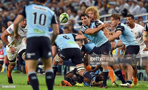 NSW Waratahs player Nick Phipps passes the ball during their Super Rugby match against the Central Cheetahs in Sydney on May 7 2016 USE