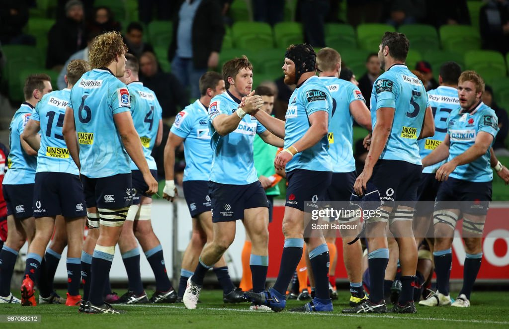 Waratahs players celebrate at the full time siren during the round 17 Super Rugby match between the Rebels and the Waratahs at AAMI Park on June 29, 2018 in Melbourne, Australia.