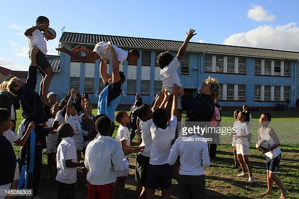 Waratahs players interact with kids during the Waratahs Corporate Social Inititaive at Bergsig Primary School in Bonteheuwel on May 23 2012 in Cape...