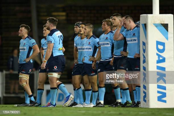 Waratahs players look dejected after the loss during the round 2 Super Rugby match between the Waratahs and the Blues at McDonald Jones Stadium on...