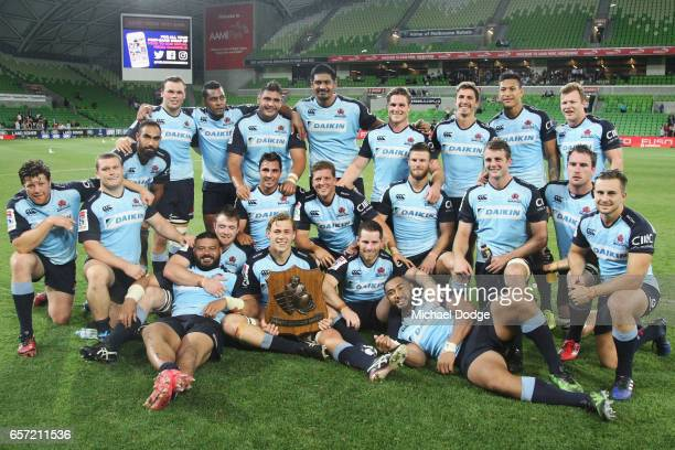 Waratahs players pose with the Weary Dunlop Shield during the round five Super Rugby match between the Rebels and the Waratahs at AAMI Park on March...