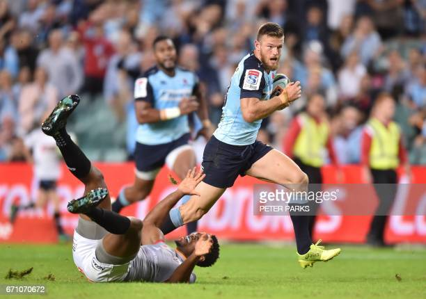 Waratahs' Rob Horne negotiates past Wandiler Mjekevu of the Southern Kings to score a try during the Super15 rugby match between Waratahs and South...