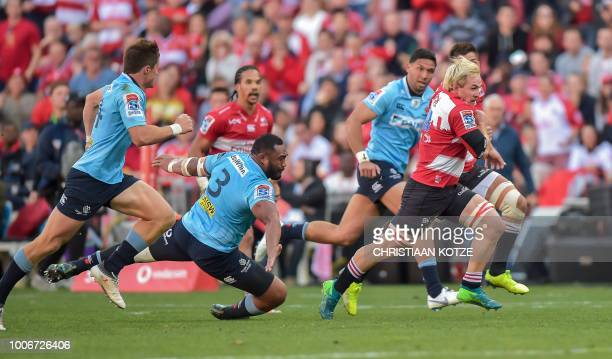 Waratahs' Sekope Kepu attempts a tackle on Lions's Marnus Schoeman during the Super Rugby semifinal match between South Africa's Lions and...