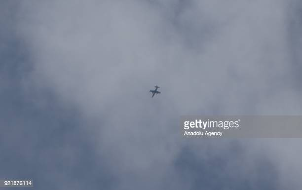 A warcraft flies over the deescalation zone of Eastern Ghouta region as Assad Regime forces carry out airstrikes over Arbin town on February 20 2018...