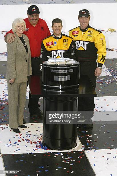 Ward Burton driver of the Bill Davis Racing Dodge Intrepid RT celebrates with team onwers Bill and Gail Davis and crew chief Tommy Baldwin after...