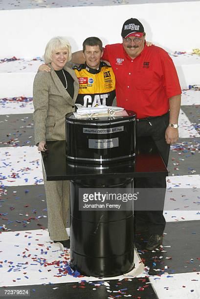 Ward Burton driver of the Bill Davis Racing Dodge Intrepid RT celebrates with team onwers Bill and Gail Davis after winning the 44th NASCAR Winston...