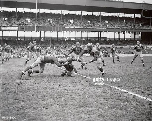 Ward Cuff of the Pro Giants Football team is pictured being hit and stopped in his tracks after taking a short pass in the first quarter game against...