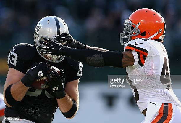J Ward of the Cleveland Browns puts his hands over the face of Brandon Myers of the Oakland Raiders as Myers catches a pass at Oco Coliseum on...