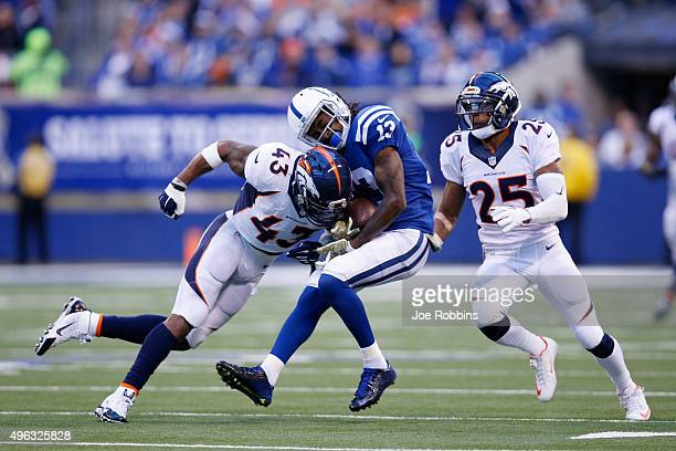Ward of the Denver Broncos tackles on T.Y Hilton of the Indianapolis Colts in the first quarter of the game at Lucas Oil Stadium on November 8, 2015...