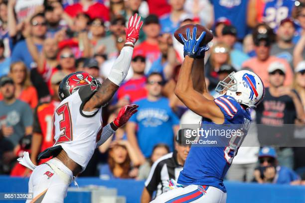 J Ward of the Tampa Bay Buccaneers attempts to defend Logan Thomas of the Buffalo Bills during the third quarter of an NFL game on October 22 2017 at...