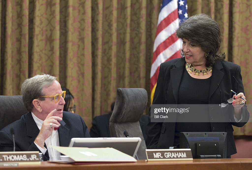 Ward One DC Councilmember Jim Graham speaks with fellow At-Large Councilmember Carol Schwartz before the start of the DC City Council meeting on Tuesday, Dec. 18, 2007.