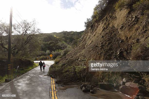 Ward Preston and his fiancée Gina Picciolo walk past a mudslide along Topanga Canyon Blvd on January 23 2017 Preston and Picciolo are longtime...