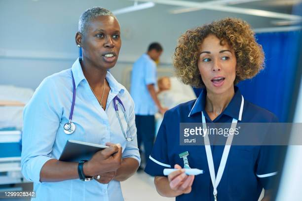ward sister with doctor - nurse stock pictures, royalty-free photos & images