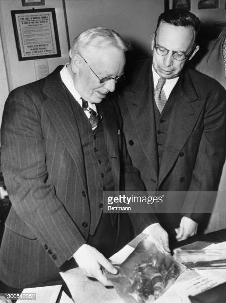Warden James A. Johnston of Alcatraz Prison and James V. Bennett, director of the Federal Bureau of Prisons, examine the implement used by Paul...