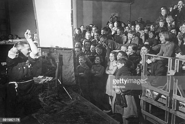 ARP warden John Hunt entertaining school children of Epsom at a South London museum during the Second World war December 1940