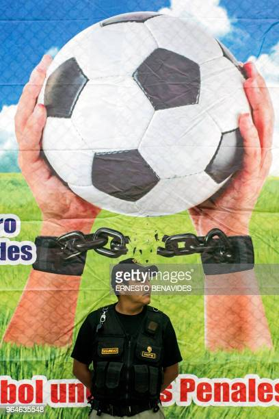 A warden stand guard during a First Interprison World Cup Russia 2018 tournament football match at the Lurigancho prison on the outskirts of Lima on...