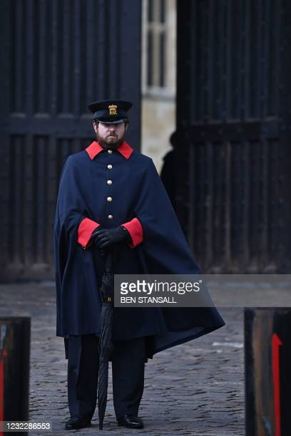 Warden stands by the entrance to Windsor Castle in Windsor, west of London, on April 13 following the April 9 death of Britain's Prince Philip, Duke...