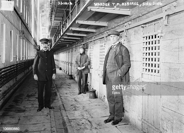Warden Thomas Mott Osborne poses by a row of cells in Sing Sing correctional prison Ossining New York State circa 1914 Osborne's brief tenure at Sing...