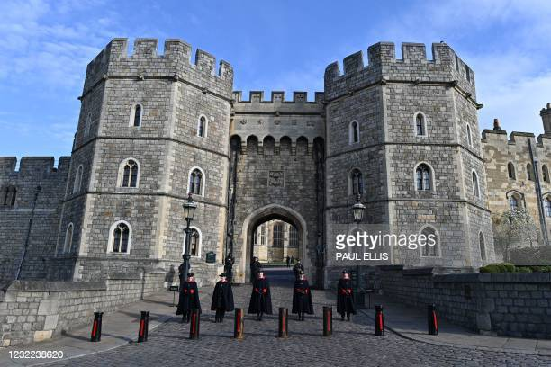 Wardens of the Castle stand in the driveway of the Henry VIII Gate at Windsor Castle in Windsor, west of London, on April 11 two days after the death...