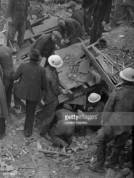Wardens rescuing people from a bomb site.