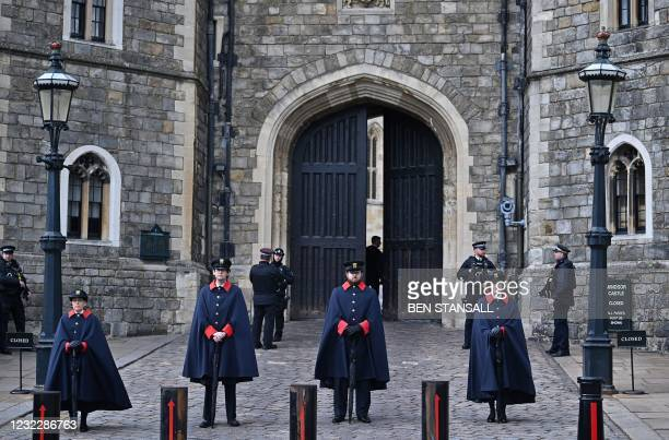 Wardens stand by the entrance to Windsor Castle in Windsor, west of London, on April 13 following the April 9 death of Britain's Prince Philip, Duke...