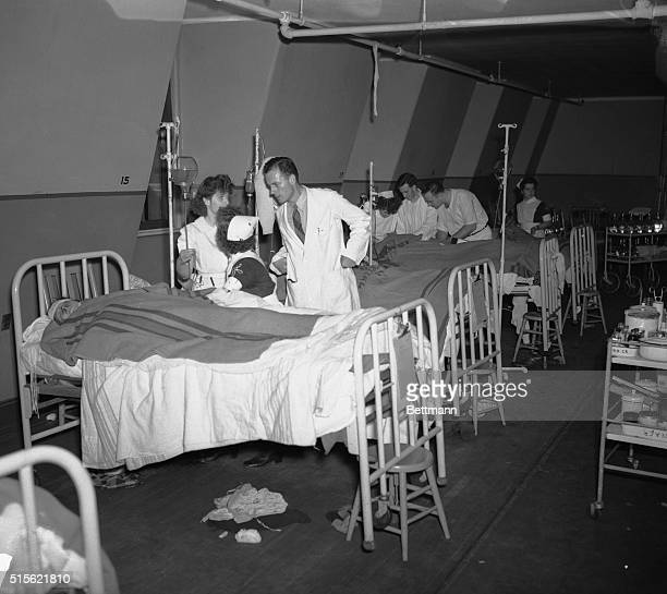 Wards and rooms of Boston Hospital were filled to capacity with victims of the Cocoanut Grove Night Club fire where 408 persons lost their lives and...