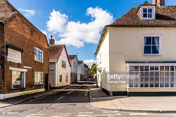 wareham high street - side road and angling shop - wareham stock photos and pictures