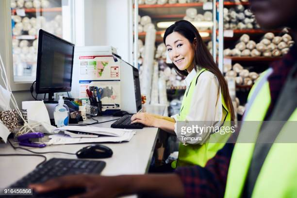 warehouse and industry concept in australia, working in small business. - east asian ethnicity stock pictures, royalty-free photos & images
