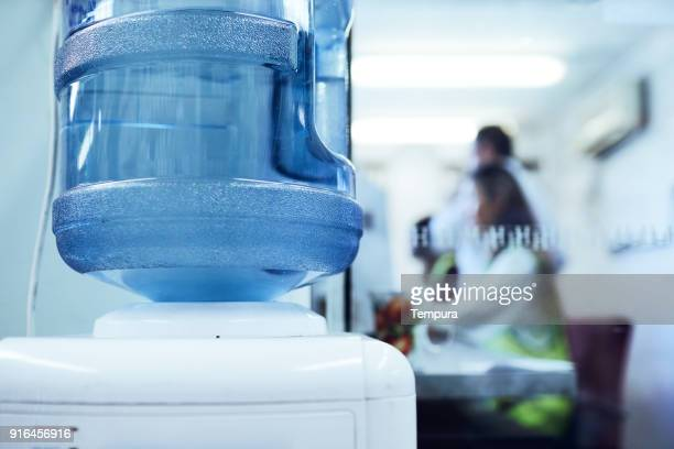 warehouse and industry concept in australia, working in small business. - mineral water stock photos and pictures