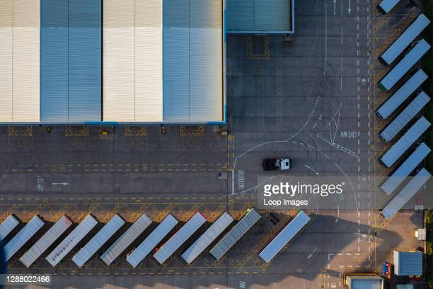 Warehouse and loading bay at sunrise taken from a hot air balloon.