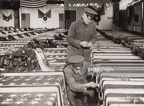 A warehouse at Antwerp docks filled with the coffins of American soldiers killed in World War I circa 1918 They are awaiting shipment home to their...