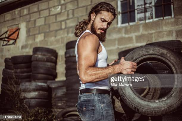 warehouse automobile tires - handsome bodybuilders stock pictures, royalty-free photos & images