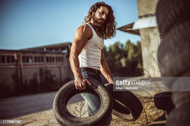 warehouse automobile tires - long hair stock pictures, royalty-free photos & images