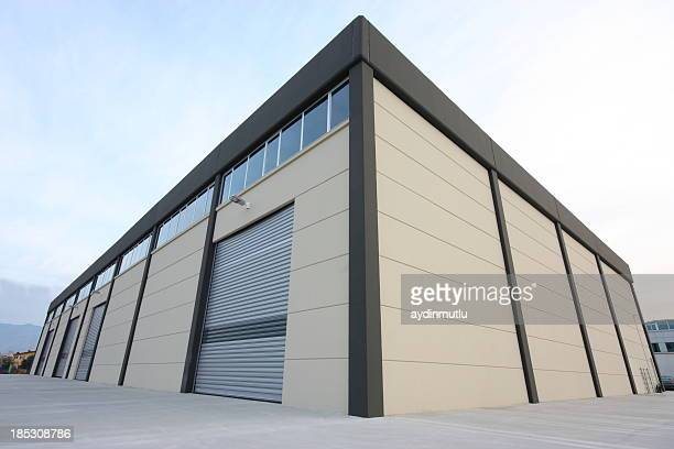 warehouse building - industrial door stock pictures, royalty-free photos & images
