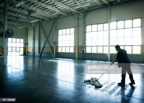 warehouse cleaning - broom stock pictures, royalty-free photos & images