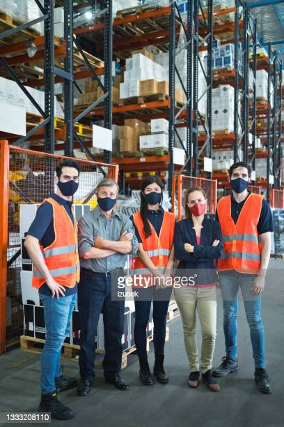 warehouse coworkers - working seniors stock pictures, royalty-free photos & images