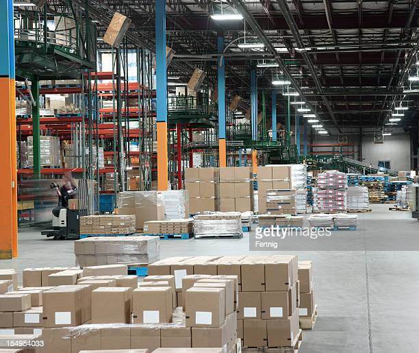 warehouse distribution center in operation. - loading dock stock pictures, royalty-free photos & images