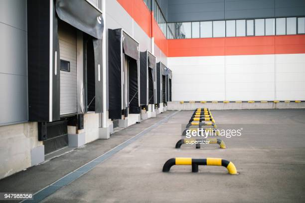 warehouse exterior - loading dock stock pictures, royalty-free photos & images