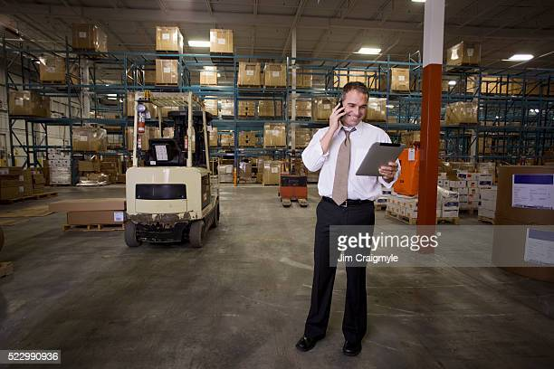 Warehouse foreman discussing an order on the phone