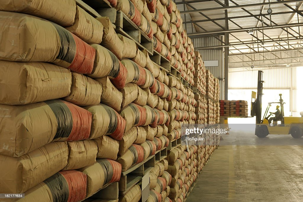 Warehouse full of sacks stacked from floor to ceiling : Stock Photo