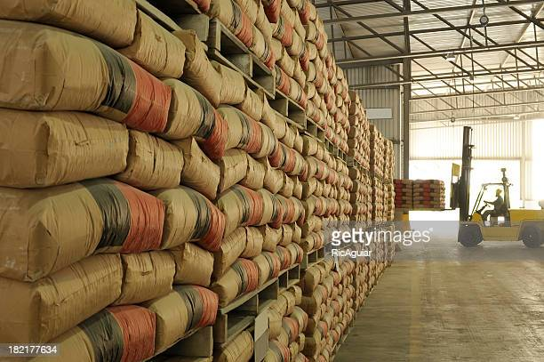 warehouse full of sacks stacked from floor to ceiling - cement stock pictures, royalty-free photos & images