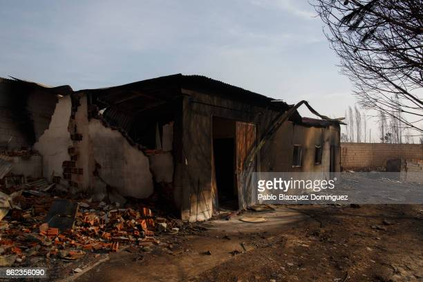 A warehouse is burnt after two people allegedly died trying to defend it from the fire near Penacova on October 17 2017 in Coimbra region Portugal At...