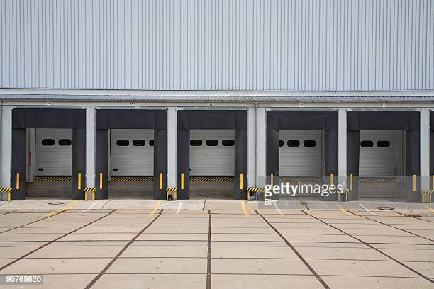 warehouse loading bays - industrial door stock pictures, royalty-free photos & images