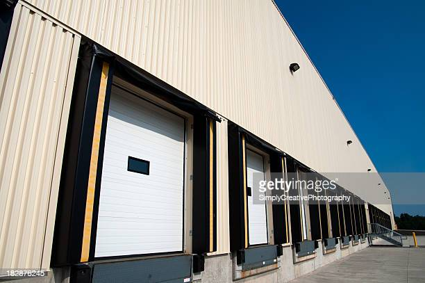 warehouse loading docks for products - industrial door stock pictures, royalty-free photos & images