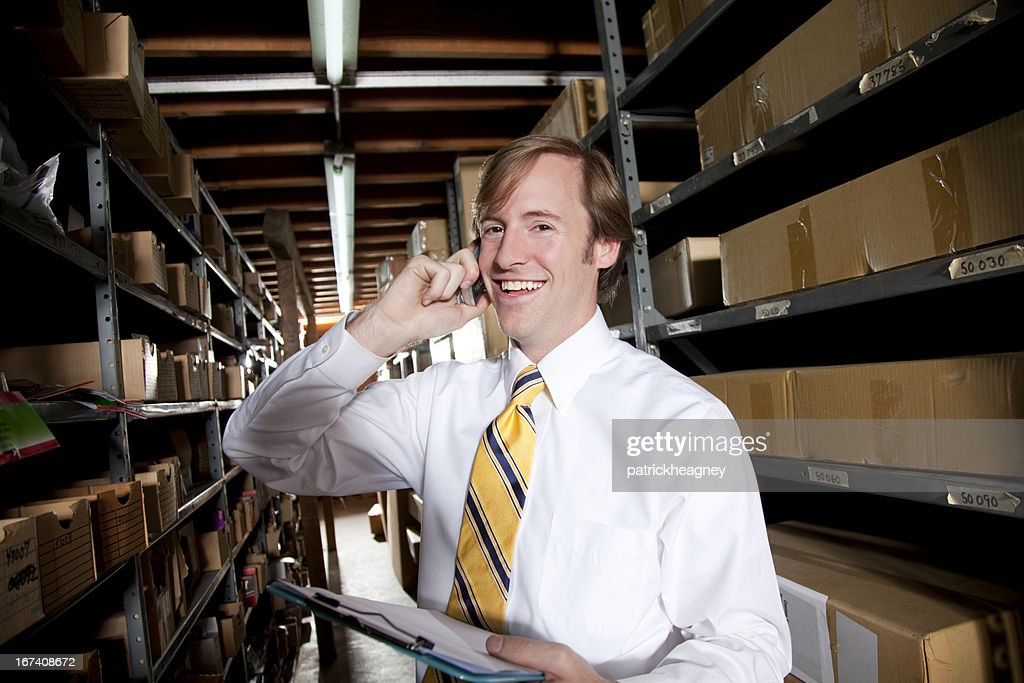 Warehouse man on phone : Stockfoto